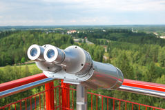 Metal Binoculars over country. Royalty Free Stock Images