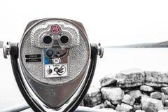 Metal binoculars at Seneca Lake in New York. A picture of metal binoculars at Seneca Lake in New York royalty free stock photo