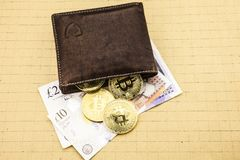 Metal bitcoins in brown leather wallet. Bitcoin - modern virtual. 3D illustration stock image