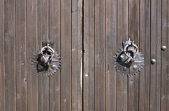 Metal black round handle on wooden doors Royalty Free Stock Photo