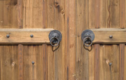 Metal black round handle on wooden doors Stock Image