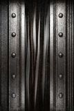 Metal on black curtain Royalty Free Stock Images
