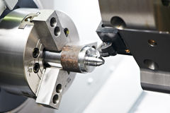 Metal blank machining process. On lathe with cutting tool stock images