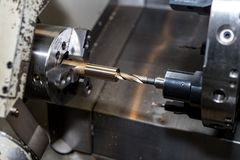 Metal blank machining process on lathe with cutting tool stock photo
