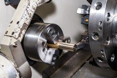 Metal blank machining process on lathe with cutting tool.  stock photos