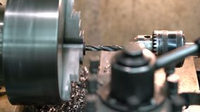 Metal blank machining process on lathe stock video footage