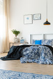 Metal and blue color. In the bedroom with double bed stock photography