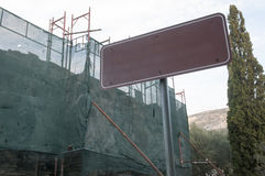 Metal board in construction site. In mountain imittos Stock Photography