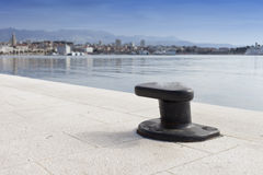 Metal bollard on the dock of pier Stock Image
