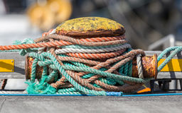 Metal bollard with ropes stock image