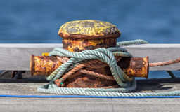 Metal bollard with ropes Stock Images
