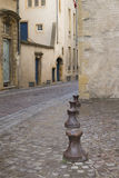 Metal Bollards on a cobbled stone street Royalty Free Stock Photo