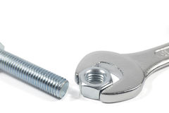 Metal Bolt And Chrome-Vanadium Spanner Gripping Nut Isolated On White Background Stock Image