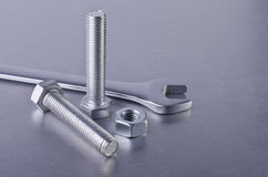 Metal bolt, nut and wrench Royalty Free Stock Image