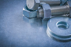 Metal bolt washers screwbolts screw-nuts on metallic background Stock Images