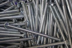 Metal Bolts for connection of iron and wooden parts royalty free stock photography