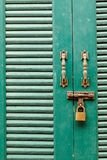 Metal bolts, latches and hooks in green wooden door Royalty Free Stock Photos