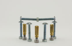 Metal bolts and screws isolated groups. Stock Photography