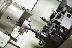 Metal boring process on machine tool Stock Photo