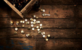 Metal bottle caps scattered on wood background Royalty Free Stock Images