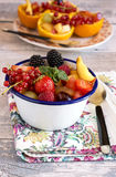 Metal bowl of fresh fruit and berries Stock Photos