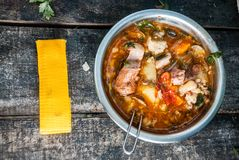 Metal bowl with goulash bogracs on a wooden table stock images