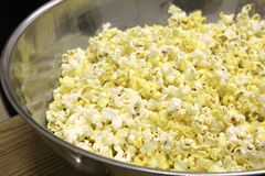 Metal bowl of popcorn ready to be eaten royalty free stock images