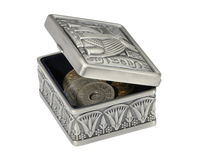Metal box in the Egyptian style with coins. Royalty Free Stock Photo
