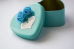 Metal box in the form of heart with the inscription `I Love You` and with roses. Blue color. St. Valentine`s Day. Metal box in the form of heart with the stock photos