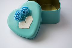 Metal box in the form of heart with the inscription `I Love You` and with roses. Blue color. St. Valentine`s Day. Metal box in the form of heart with the royalty free stock image