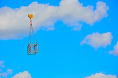 Metal box hanging in the blue sky Stock Photo