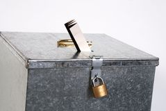 Metal box with padlock ticket voting Stock Images