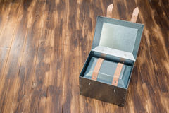 Metal box in side of metal box on wooden table Royalty Free Stock Photos