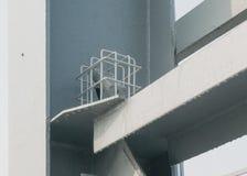 Metal bracket. Lamp with grille mounted on a metal bracket pedestrian bridge bracket closeup Royalty Free Stock Image