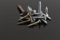 Metal and brass screws Royalty Free Stock Image