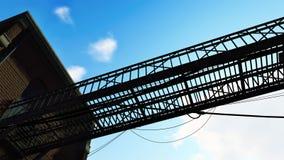 Metal bridge against blue cloudy sky Royalty Free Stock Photos
