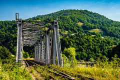 Metal bridge in Carpathian countryside. Old metal rail road bridge in rural area of carpathian mountains Royalty Free Stock Image