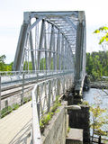 Metal bridge. Grey metal bridge over the river Stock Photos