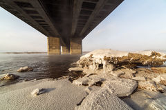 A metal bridge over the icy. Enisey river in Krasnoyarske Stock Image
