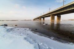 A metal bridge over the icy. Enisey river in Krasnoyarske Stock Images