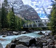 Bridge over the Kicking Horse river in Canadian Rockies stock images