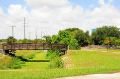 Metal bridge over pond Royalty Free Stock Images