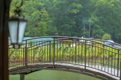 The metal bridge over the River in the rain stock photo