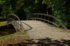 A metal bridge in the park Stock Images