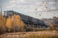 Metal bridge for the railway. Old bridge in the city of Barnaul. Enclosed with barbed wire stock photos