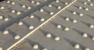 Rivets on a metal bridge. On the metal bridge rivets for fastening metal structures stock video