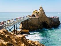 Metal Bridge towards the Rocher de la Vierge Royalty Free Stock Photo