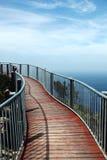 Metal bridge with wooden slats. Metal bridge with support pillars on wooden slats Royalty Free Stock Photos