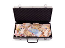 Metal briefcase full of cash Stock Photo