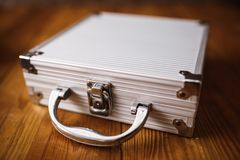 Metal Briefcase on wood table.  Stock Images